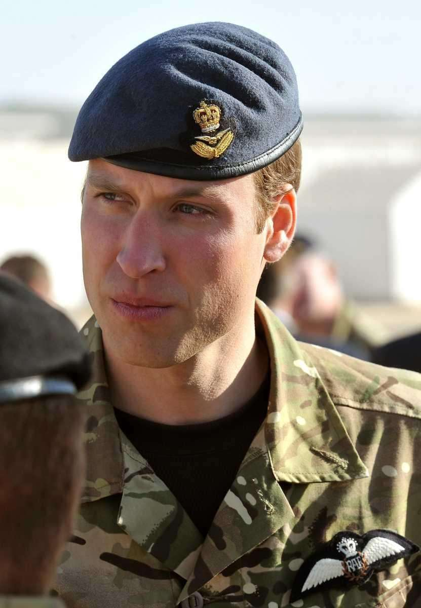 Britain's Prince William talks to soldiers before a