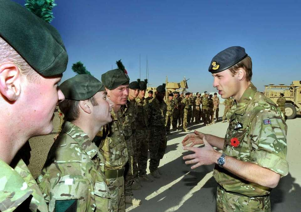 Prince William talks to members of the Royal