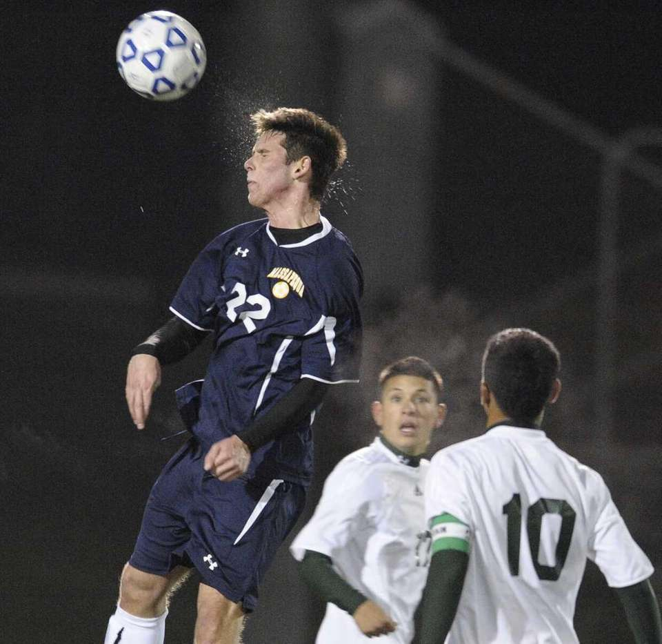 Massapequa's Connor Nealis goes for a header against