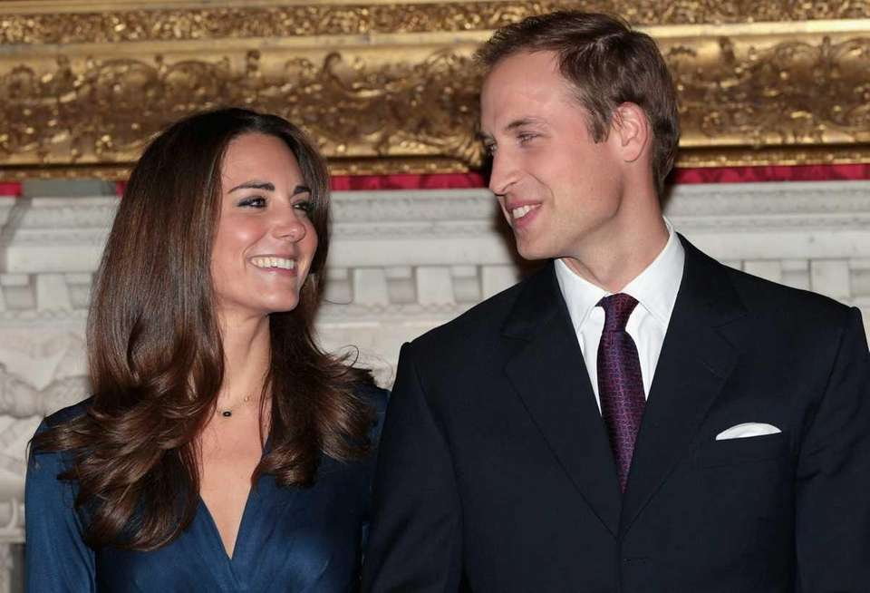 Prince William and <Kate Middleton pose for photographs