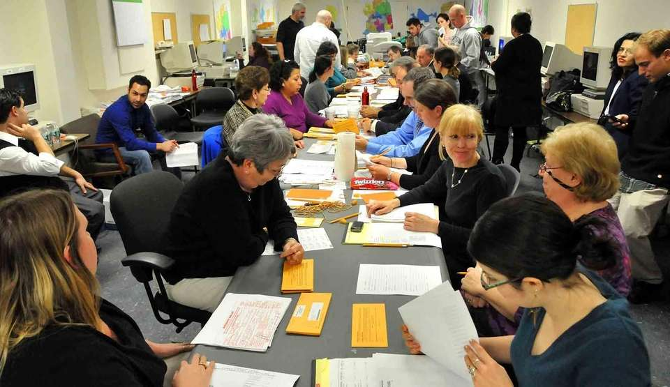 Nassau County election volunteers continue count absentee ballots