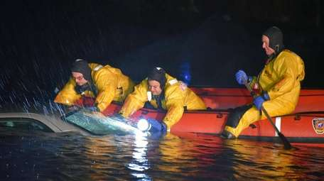 Rescuers at the car in Millers Pond in