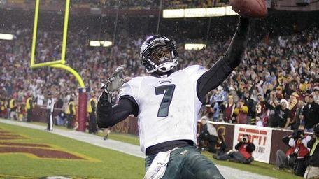 Philadelphia Eagles' Michael Vick celebrates his 2nd-quarter touchdown