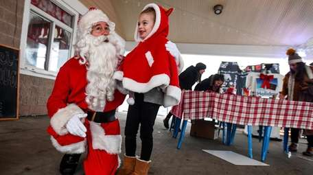 Adalyn Janawsky, 6, of Babylon, meets Santa, played