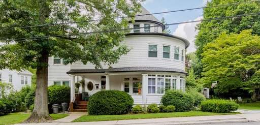 This two-family Manhasset home has nine bedrooms and