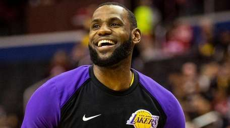 Lakers forward LeBron James warms up before a
