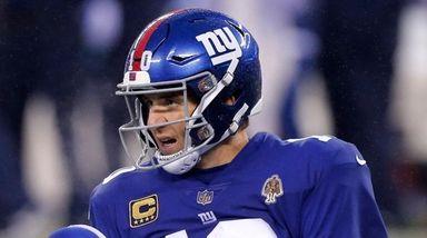 Giants quarterback Eli Manning looks on after he