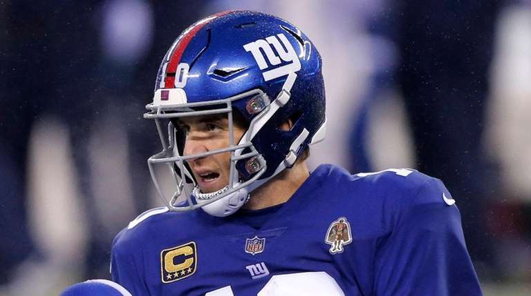 Giants quarterback Eli Manning looks on after he