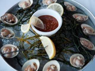 The clams are served on ice at Louie's