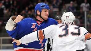 Rangers left wing Derek Boogaard, left, fights Edmonton's