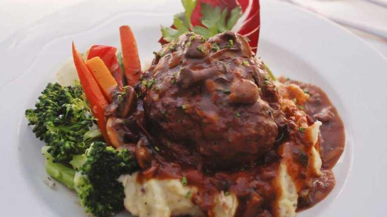 Meat loaf with mashed potatoes and hunter gravy