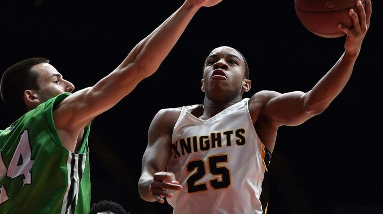 Latrell Williams #25 of Uniondale, right, drives to