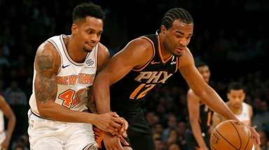The Knicks' Lance Thomas battles for a loose