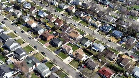 Aerial views of suburbs in Levittown taken April
