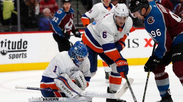 Islanders goaltender Thomas Greiss stops a shot off