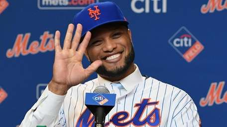The Mets' Robinson Cano reacts during a press