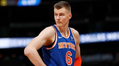 Knicks forward Kristaps Porzingis reacts after fouling out