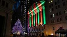 The NYSE is bathed in holiday light on