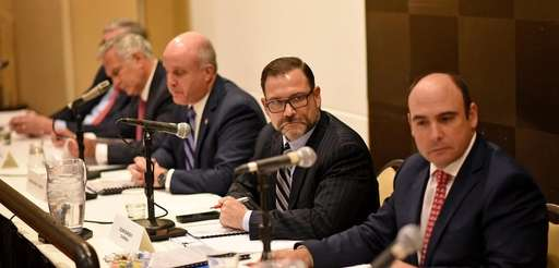 NIFA chair Adam Barsky, center, during a public