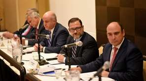 NIFA chair Adam Barsky, center, during a public