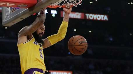 The Lakers' Tyson Chandler dunks over the Heat's