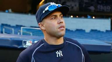 Yankees rightfielder Carlos Beltran comes out from the