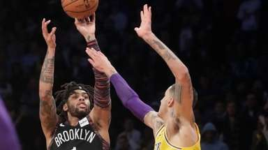 The Nets' D'Angelo Russell shoots over the Lakers'