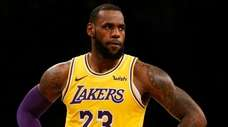 The Lakers' LeBron James looks on during the