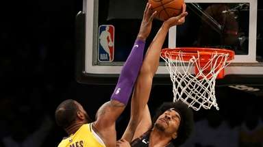 The Nets' Jarrett Allen blocks a shot from