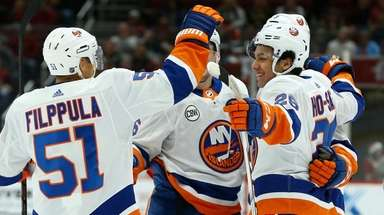 Islanders right wing Joshua Ho-Sang smiles as he