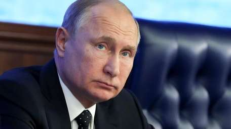 Russian President Vladimir Putin attends a meeting with