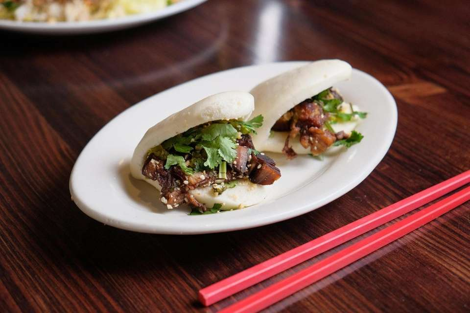Taiwanese pork buns with cilantro and chopped peanut,