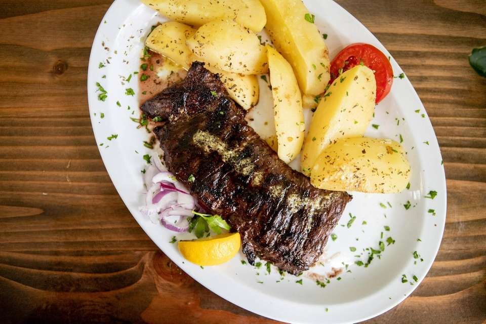 The skirt steak platter with lemon potatoes at