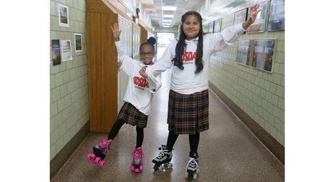 Kidsday reporters Elisha Mathurin, left, and Jaslyn Chavez