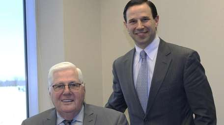 Edward Paternostro, left, president and CEO at NEFCU,