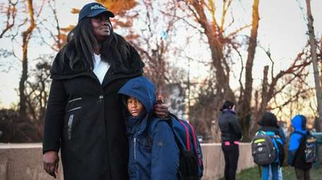 Indiana Bumpers stands with her grandson Giovanni Berry,