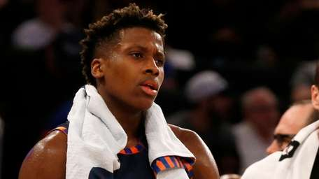 The Knicks' Frank Ntilikina looks on after fouling