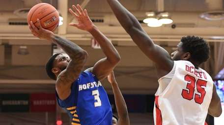 Hofstra guard Justin Wright-Foreman puts up a shot