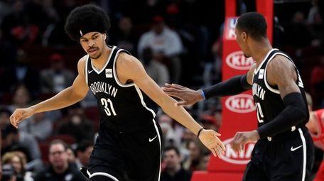 Nets center Jarrett Allen, left, celebrates with forward