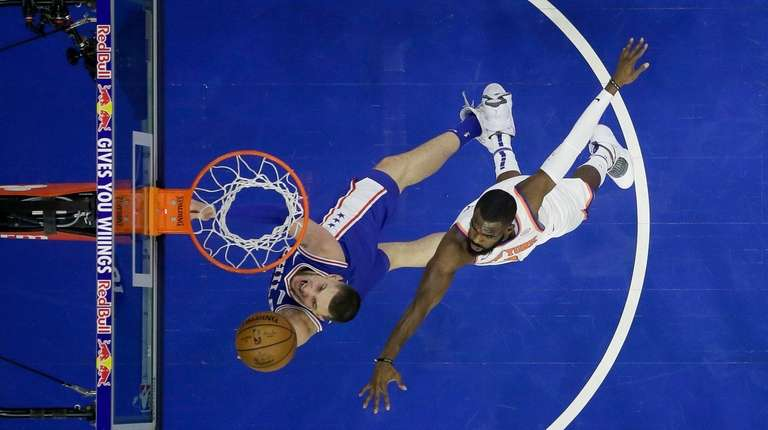 The 76ers' Mike Muscala goes up for a