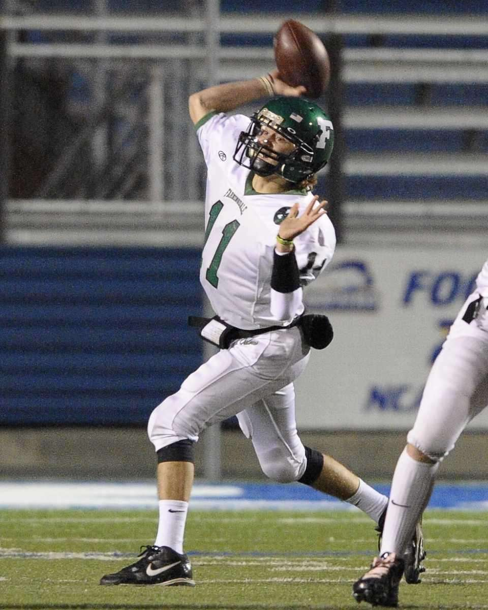 Farmingdale quarterback Sal Tuttle looks to throw a