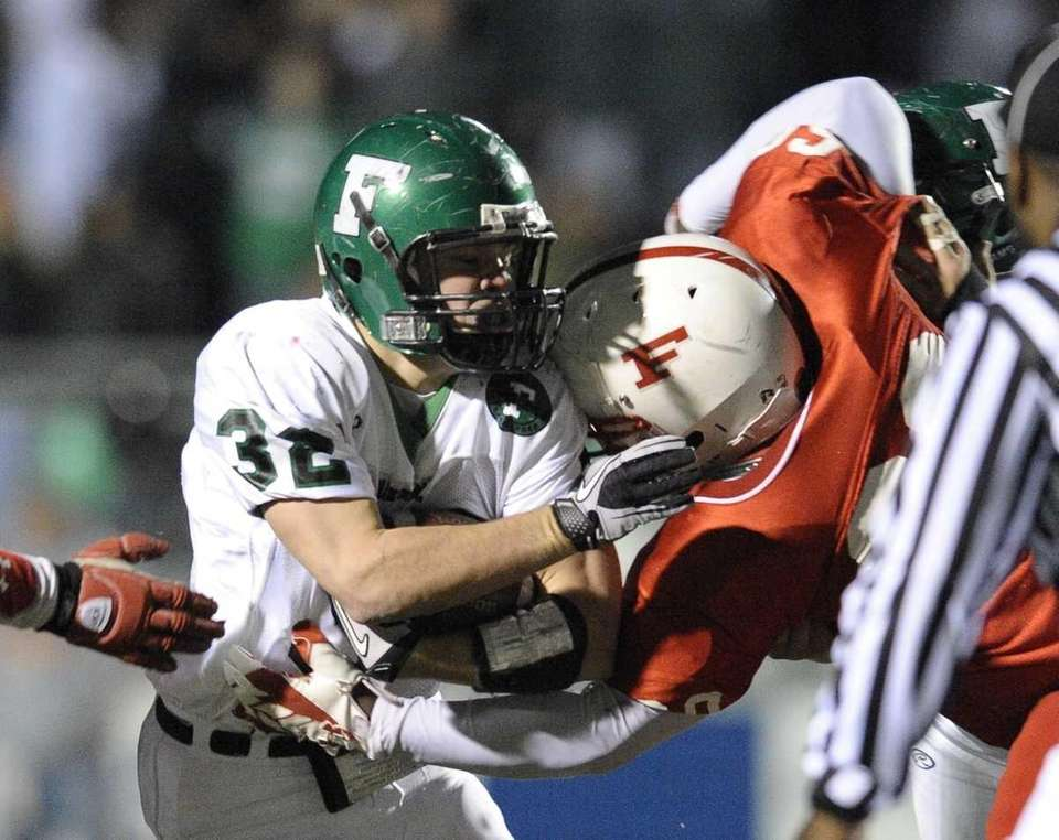 Farmingdale's Kevin Wahl is tackcled by Freeport's Jovani