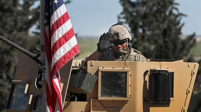 A U.S. soldier signals on the way to