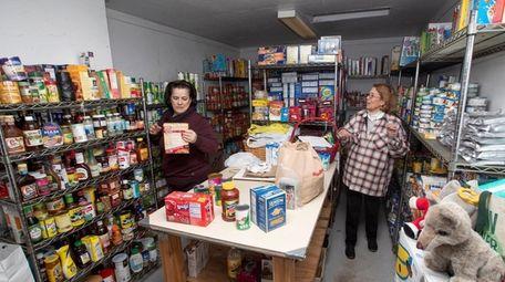 Sarah Isaacson, left, and Mary Lou Cohalan volunteer