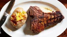 The LongHorn porterhouse steak weighs in at 22