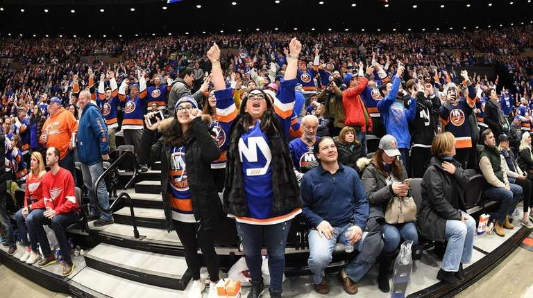 Islanders fans react in the third period against