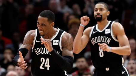 Nets forward Rondae Hollis-Jefferson, left, and guard Spencer