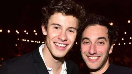 Shawn Mendes, left, and Scott Harris attend Spotify's