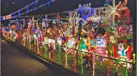The Christmas light display at Middle Country teacher