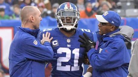 Giants strong safety Landon Collins is assisted by